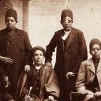 African slaves in Iran during the Qajar era were often eunuchs. Their dress suggests that they belonged to the king or high-ranking members of his court. From right: Aqay-i 'Almas khan, Aqay-i Bahram khan, Aqay-i Masrur, Aqay-i A Seyid Mustafa, Aqay-i Iqbal khan, and Aqay-i Yaqut khan, 1880s. Photograph: Modern Conflict Archive, London, UK