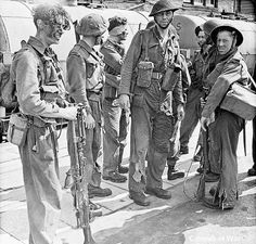 Soldiers who took part in Operation Jubilee, the raid on Dieppe, returning to England
