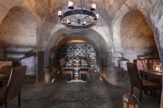 George Fakaros™ Architectural Photography | www.fakaros.com Experience ceremonial wine tasting or exquisite fine dining in Mystique's Secret Wine Cave, a dramatic 150 year old wine cellar with the most rare and indigenous wine selection.
