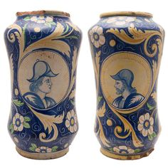 Mid-19th Century Pair of Italian Majolica Urns | From a unique collection of antique and modern vases and vessels at https://www.1stdibs.com/furniture/decorative-objects/vases-vessels/
