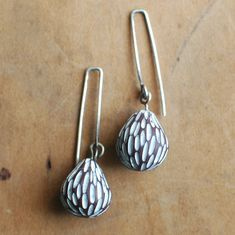 Organically shaped carved drops. Rustic. Modern. Unique. These are my new favorites. I love how they hang and swing just a bit. The squared off ear