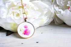Such a thoughtful gift idea! Make this DIY resin jewelry birth month flower pendant. A personalized birthday, Mother's Day or Christmas gift idea for her.