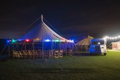 Unique canvas tents for special events. Original Victorian ceremony tent adorned with coloured festoon lighting.