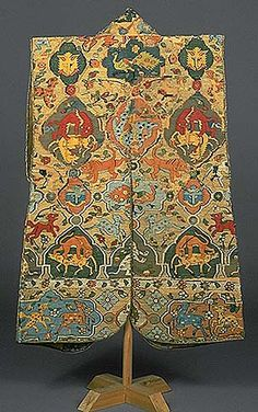 This jinbaori vest was made to wear over armor. It was reportedly owned by Regent Toyotomi Hideyoshi and has been preserved through time by Kodai-ji Temple, established in memory of Hideyoshi by his widow, Kita-no-Mandokoro. This vest was woven of silk using tapestry techniques. The textile may originally have been a carpet made in Kashan in Persia. The design of a lion attacking his prey is a traditional motifs in Persian carpets. Such carpets were imported into Japan