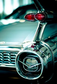 Fins like this only found on the 1959 Caddy one of my dads dream cars the coupe deville to be exact