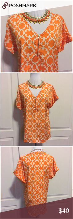 """Orange and White Casbah Print Zip Front Blouse S Tangerine orange and white casbah print short sleeve blouse by Blue Rain. Size small. From Francesca's. No flaws. Relaxed fit. Zipper accent in the front. Rolled short sleeves. Approx 22"""" across the bust and 27.5"""" long from center back collar to bottom hem. 100% poly. Drapes beautifully! Smoke-free home. No trades. Offers welcome!💕 Francesca's Collections Tops Blouses"""