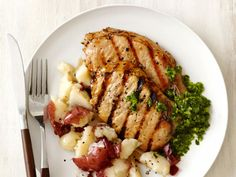 Pork Chops with Smashed Potatoes and Chimichurri Sauce by Food Network. I could put this chimichurri on ANYTHING and it would taste good. Sauce Recipes, Pork Recipes, Pork Meals, Parmesan Recipes, Thm Recipes, Delicious Recipes, Recipies, Food Dishes, Main Dishes