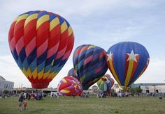 Hot air balloons are prepared for launch just before 7 a.m. on the final day of the Wichita River Festival.