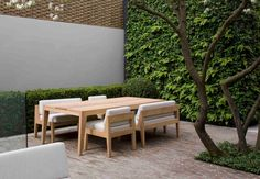 A range of outdoor furniture made from FSC Iroko wood. Designed by Nathalie de Leval. Outdoor Rooms, Outdoor Dining, Outdoor Chairs, Outdoor Decor, Garden Furniture, Outdoor Furniture Sets, Sofa Dining Table, Modern Landscaping, Outdoor Settings