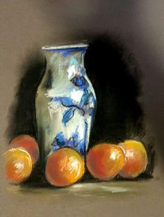 Vase and oranges