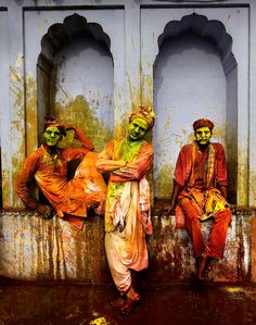 Villagers from Nandgaon wait for the arrival of villagers from Barsana to play Lathmar Holi at the Nandagram temple famous for Lord Krishna and his brother Balram, in Nandgaon, India, on Friday, on March (Photo by Manish Swarup/Associated Press) Holi Festival India, Holi Festival Of Colours, Holi Colors, Wild In The Streets, Holi Images, Holi Pictures, Religion, Visit India, Happy Holi