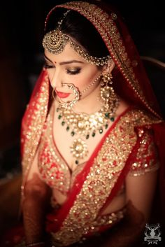 Bride Wearing Polki Bridal Jewellery with Green Stones