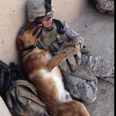 Two of my heros...soldiers and dogs.