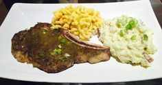 NY skirt steak with potato salad and Mac and cheese