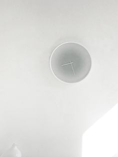 'Time' wall clock by Studio Like This.    A clock which requires time be sought out rather than have it as a constant reminder of its passing. Only when approached front-on does the clock allow for the transparency to read time. Viewed from any other angle it disguises itself as a discreet wall object.