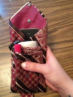 3 pocket clutch from a tie. I can put my Chapstick, camera, and my phone (in the back pocket) in my pouch! And any debit cards and cash as well! It can hold quite a bit.
