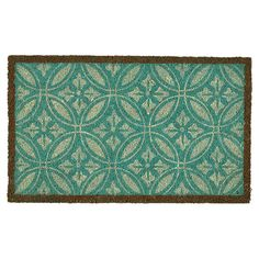 Infuse your entryway or patio with a sophisticated pop of color with this coir doormat, showcasing a medallion-inspired motif and cool palette.