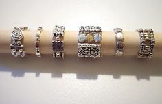 DIY stretch rings ..... hmmm..... small sterling beads and flat stones....