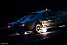 When's the last time you saw classic cars racing at night?