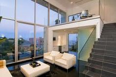 Modern penthouse by the ocean .