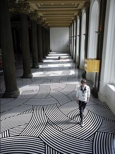Jim Lambie is a Scottish artist who has the specificity to cover surfaces with colorful adhesive tapes. The way he arranges these bands create a hypnotic and puzzling visual fields. Moreover, the artist doesn't hesitate to intervene in very traditional places to produce a surprising contrast.