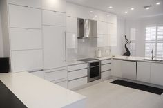 High gloss white acrylic kitchen by Da Vinci Cabinetry in Naples, FL