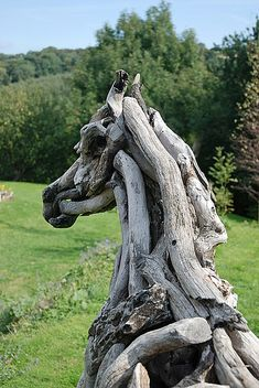 horse sculptures made out of driftwood by Heather Jansch