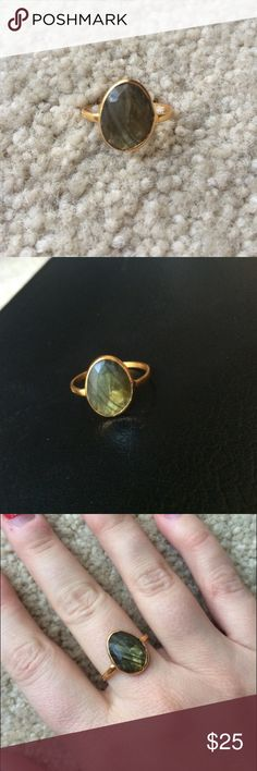 NEW Semi Precious Stone Ring Brand new in box semi precious stone ring with gold colored band. Stone is a beautiful green with hints of grey. Blue Door Boutique Jewelry Rings