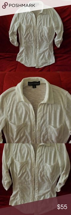 White Button-down Top Obsessed with this top to just throw over any plain outfit and make it hotter. Goes really well with jeans, especially skinny jeans. I purchased at Macys and wore about 3 times but now my bicep is a tad big for the sleeve Almost Famous Tops Button Down Shirts
