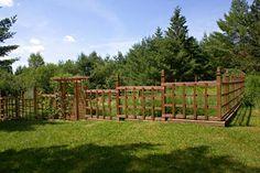 garden fencing ideas   Red cedar garden fence outside of Ely