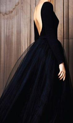 Black tulle dress. Very chic and elegant with an updo. I would like it a little shorter, so that the ankles and shoes are clearly visual. It would also give a romantic, ballerina look.