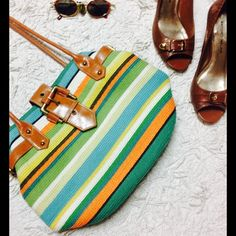 Summer Striped Beach Purse ️Fun and bright summer purse. Great condition! Great design. 11 inches long, 6 inches wide, (10in tall purse, with straps 21 inches total.) some loose strings here and the can be cut off. No stains or tears. Light blue interior. Buckles on side and front. Magnetic button closes purse to strap. 2 interior pockets and large zipper pocket. Final price. Bags