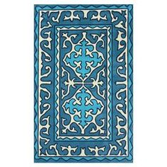 Hand-tufted rug with a decorative motif.     Product: RugConstruction Material: 100% PolyesterColor: BlueFeatures: Hand-tuftedNote: Please be aware that actual colors may vary from those shown on your screen. Accent rugs may also not show the entire pattern that the corresponding area rugs have.Cleaning and Care: These rugs can be spot treated with a mild detergent and water. Shake rug from time to time to restore its natural good looks and beauty.