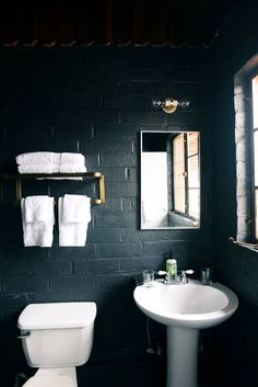 black-painted brick bathroom.