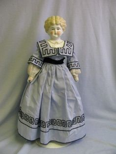 """22"""" Early Pet Name """"RUTH"""" China head Doll with molded collar Dressed Ca.1910      Zoom unavailable     Enlarge  Sell one like this  22"""" Antique Pet Name """"RUTH"""" China head Doll with molded collar Dressed Ca.1910"""
