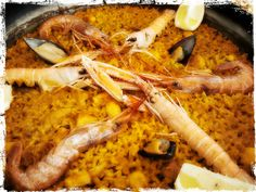 Mauro's photo is making us hungry. This paella shot looks like it's got some extra yellow added to the photo that goes beyond the saffron, and we love the rustic border. Thanks for sharing, Mauro! Hope it was delicious. Submit your own. Valencia (by mauro_ventura)