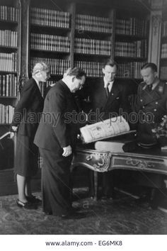 Hermann Goering at 'Einsatzstab Rosenberg' headquarters in Paris, France. Alfred Rosenberg is in uniform next to art historian and dealer Bruno Lohse (second from right).   On March.10, 1942