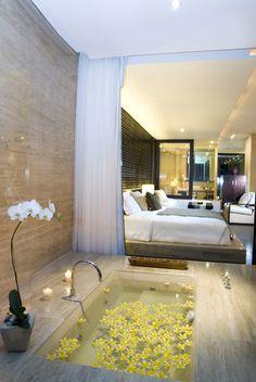 Sunken Bathtub that's more like a private pool in the bedroom at Anantara Seminyak Resort and Spa in Bali, Indonesia