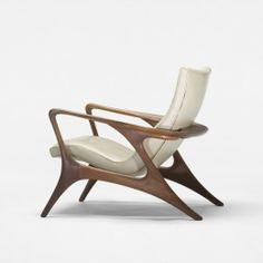 Vladimir Kagan  Contour lounge chair        Kagan-Dreyfuss, Inc.USA, c. 1953   walnut, leather29.5 w x 34 d x 32 h inchesSigned with branded manufacturer's mark to underside: [Kagan-Dreyfuss Inc.]. s10