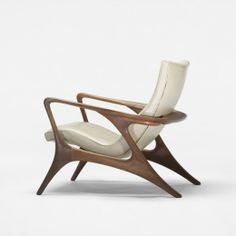 Vladimir Kagan  					Contour lounge chair      					  						Kagan-Dreyfuss, Inc.USA, c. 1953   walnut, leather29.5 w x 34 d x 32 h inchesSigned with branded manufacturer's mark to underside: [Kagan-Dreyfuss Inc.]. s10