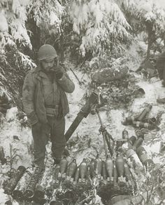 WWII - A U. First Army soldier manning an mortar listens for fire direction on a field phone during the German Ardennes offensive, 19 December Nagasaki, Hiroshima, Fukushima, History Online, World History, Military Photos, Military History, Vietnam, Ardennes
