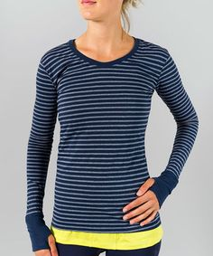 Dial up the intensity of that morning jog with a tee that was made to push the limits. Cozy long sleeves with thumbholes seal in warmth when there's a chill in the air, and the stripey, figure-flattering design turns any workout into a stylish statement.