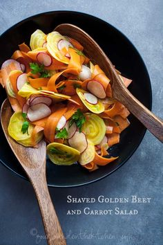 A simple and refreshing salad of shaved golden beet, carrot and radish with a kicky vinaigrette.