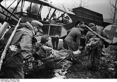 "Wounded German troops - south of the struggles of Pripyat - be transported away from the main battle line by light aircraft ""Fieseler Storch"". Soviet Union, mid february 1944."