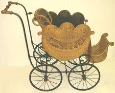 *ANTIQUE HEYWOOD WAKEFIELD WICKER BABY STROLLER: Ornate turn-of-the-century Heywood Wakefield baby stroller or pram. The footrest + back are adjustable. The orinal padded green fabric interior. We do not have the parasol.