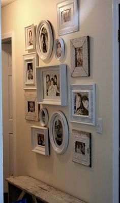 I really like the white frames grouped together. I am going to do this for my mum for her birthday!!