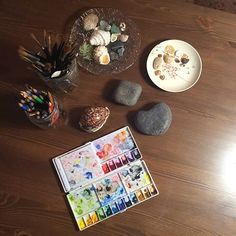 My paint palette, brushes and inspiration from nature.