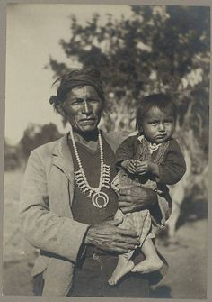 Man and Infant on Navajo Reservation  by Simeon Brother Schwemberger, 1906 National Anthropological Archives. Photo, father and son ? indian, culture, native american, portrait, history