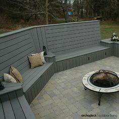 Gray composite deck with high-back built-in benches for seating ...