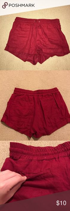 Casual Shorts These are red shorts that I have worn multiple times but they are in perfect condition besides the back of the shorts unfolding a little at the bottom. Draw string in front plus pockets in front. Material is 51% linen and 49% rayon. Forever 21 Shorts